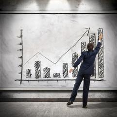 Businessman shows economic growth