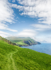 Trekking on the scenic island Mykines, Faroe island.