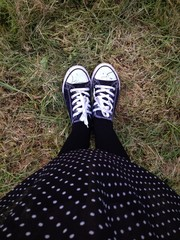 standing in polka dots and trainers