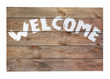 "Vintage ""welcome"" wooden sign isolated on white background."