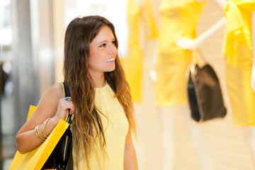 Smiling young woman shopping in the city