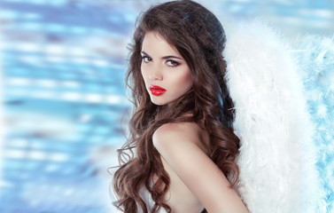 Beautiful brunette girl angel over disco party lights background