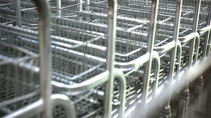 Rows of shopping carts near entrance Of supermarket