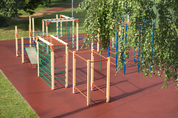 Children Playground outdoors in summer park after rain