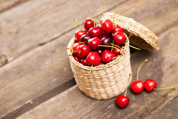 Juicy cherries in a wicker basket