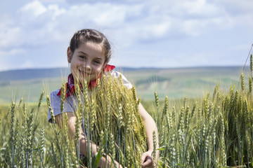Young girl on a wheat field.Blurred background