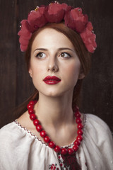 Redhead girl in ukrainian national clothing.