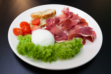 plate of meat with mozzarella