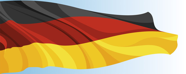 The national flag of the Germany on a background of blue sky