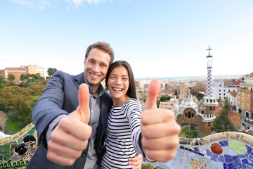 Travel couple happy in Park Guell, Barcelona