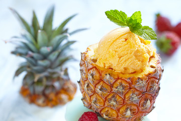 Fruit sorbet ice cream in small pineapple