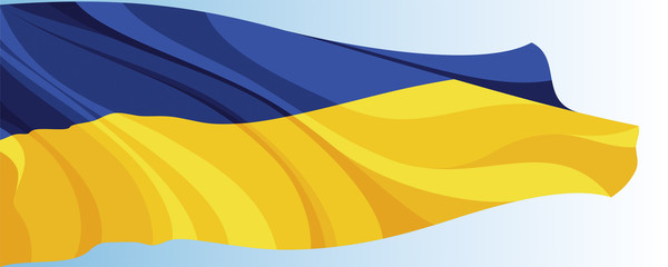 The national flag of the Ukraine on a background of blue sky