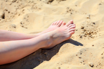 Female feet on a sand