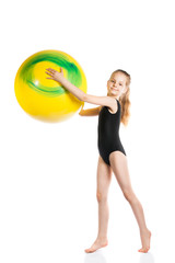 girl gymnast with a yellow ball