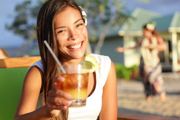 Woman drinking alcohol Mai Tai drink on Hawaii