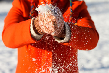 woman hand in snowed gloves