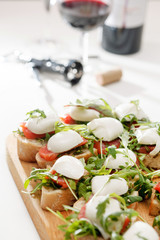 Tomato, mozzarella and arugula sandwich