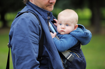 Father and his baby in a baby carrier
