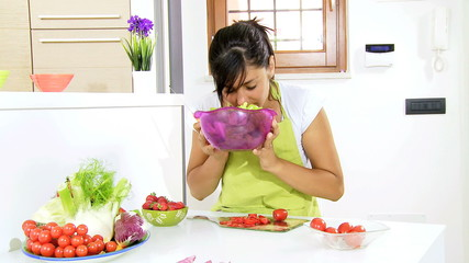 Woman smelling fresh salad