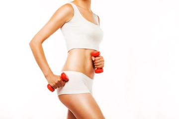 Young sports woman with red dumbbells on a white background