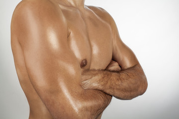 Naked, muscular torso of the athletic man