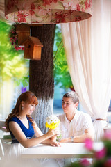 Outdoor portrait of young sensual couple in summer cafe. Love an