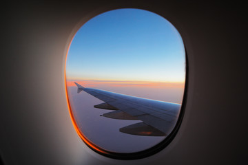 A window view of the wing at dawn