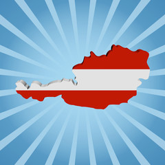 Austria map flag on blue sunburst illustration