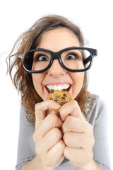 Funny geek girl eating a cookie