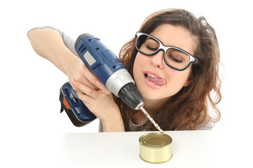 Funny geek girl trying to open a tin with a drill