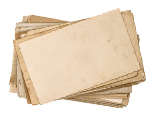old postcards isolated on white. aged paper texture