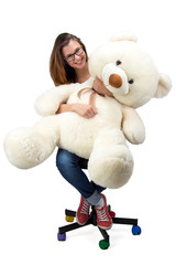 Sitting young teenager with teddy bear