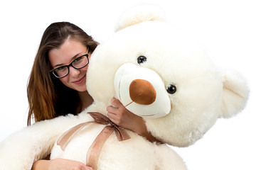 Happy young teenager with teddy bear