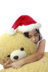 Pretty little asian girl hugging big bear