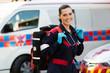 female paramedic carrying lifepack - 66638583