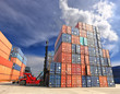 forklift handling the container box at dockyard with blue sky