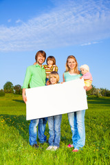 Smiling family holds white square paper format