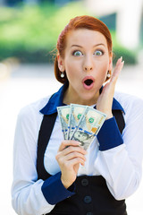 Portrait, headshot excited, surprised woman holding dollar bills