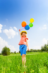 Small girl with colorful balloons wearing circlet