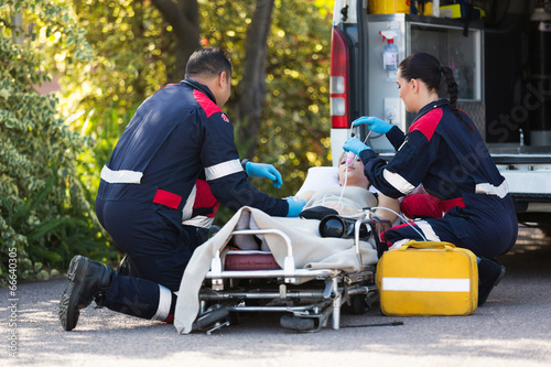 emergency medical staff rescuing patient - 66640305