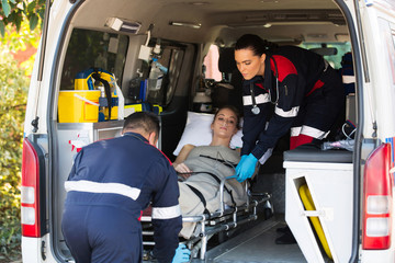 emergency medical staff transporting patient