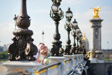 Just married couple on the Alexandre III bridge