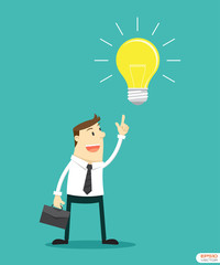 Businessman pointing at light bulb to getting Idea