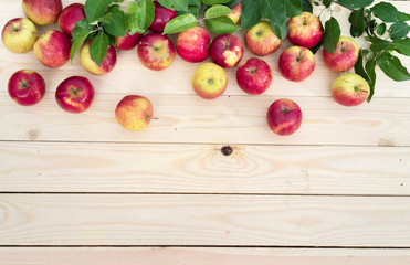 Apples on wooden board background