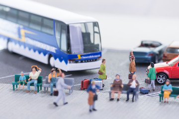 Miniature travellers at a busy bus station