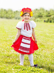 Happy girl in russian folk clothes