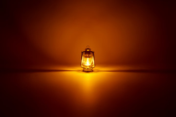 Burning kerosene lamp background, concept gold light