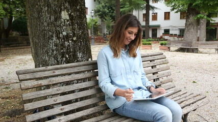 Young Woman Using Digital Tablet Outdoor