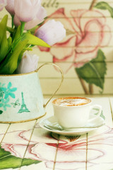 hot cappuccino on paint wooden table with vintage style