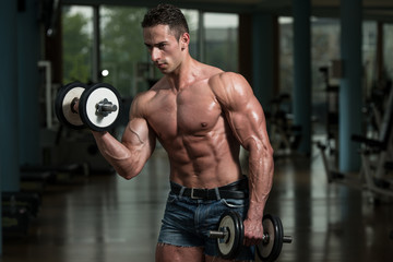 Young Man Working Out Biceps